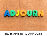 Small photo of adjourn colorful word on the wooden background