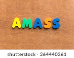 Small photo of amass colorful word on the wooden background