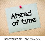 Small photo of Ahead of time Message. Recycled paper note pinned on cork board. Concept Image