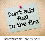 Small photo of Don't add fuel to the fire Message. Recycled paper note pinned on cork board. Concept Image