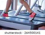 fit female legs on a treadmill...   Shutterstock . vector #264500141