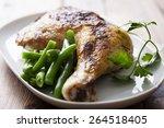 roast chicken leg with green... | Shutterstock . vector #264518405