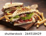 ham and bacon club sandwich on... | Shutterstock . vector #264518429