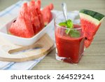 fresh watermelon and glass of... | Shutterstock . vector #264529241
