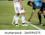 blurry referee  marks kick off... | Shutterstock . vector #264596375