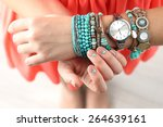 Stylish Bracelets And Clock On...