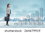 business woman climbing up on... | Shutterstock . vector #264679919