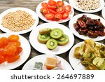 different products on saucers... | Shutterstock . vector #264697889