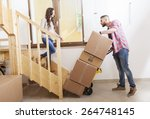 young couple carrying the boxes ... | Shutterstock . vector #264748145