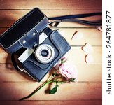 vintage camera and roses | Shutterstock . vector #264781877