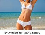 Young Woman In White Bikini...