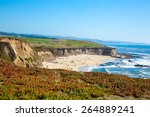 Beach And Seaside Cliffs At...