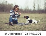 Stock photo woman having fun with her dog 264961301