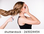 girl cut her hair | Shutterstock . vector #265024454