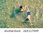 Постер, плакат: Playful children swimming in