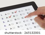 finger clicking on a tablet... | Shutterstock . vector #265132001