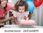 Two Year Old Baby Girl Blows...