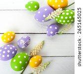 colorful easter eggs on white...   Shutterstock . vector #265165025