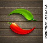 two chili peppers on wooden... | Shutterstock .eps vector #265166465