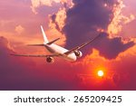 air plane flying with sunset | Shutterstock . vector #265209425