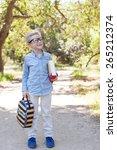 cute little schoolboy in... | Shutterstock . vector #265212374