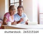 happy senior couple sitting at... | Shutterstock . vector #265215164