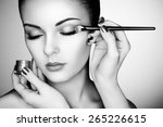 makeup artist applies eye... | Shutterstock . vector #265226615