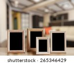 photo frames on the wooden... | Shutterstock . vector #265346429