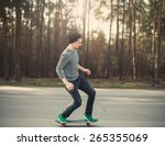 male skateboarder skating in... | Shutterstock . vector #265355069