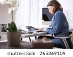 busy pretty young businesswoman ... | Shutterstock . vector #265369109