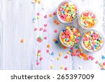 Colorful Sprinkles In Bowls On...