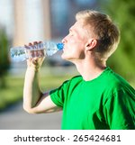 Tired Man Drinking Water From ...