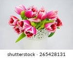 bunch of pink tulips in a white ... | Shutterstock . vector #265428131