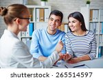 happy young couple making deal... | Shutterstock . vector #265514597