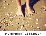 Top View Of Child Feet In The...
