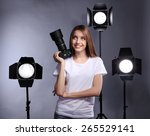 young female photographer... | Shutterstock . vector #265529141