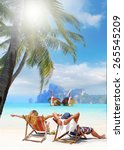 couple on the beach at tropical ... | Shutterstock . vector #265545209
