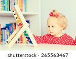 little girl playing with abacus ... | Shutterstock . vector #265563467