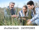 Small photo of Teacher with students in agronomy looking at vegetation