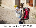 young woman tourist carrying... | Shutterstock . vector #265620581