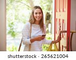 young woman returning home for... | Shutterstock . vector #265621004