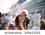 Stock photo beautiful girl wearing sakura flower hat smiling at the dubai world cup horse race 265622201