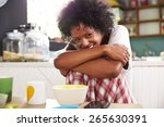 portrait of young woman eating... | Shutterstock . vector #265630391