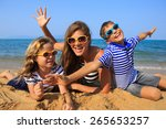 happy family   mother and two... | Shutterstock . vector #265653257