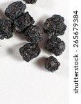 heap of dried aronia berries. | Shutterstock . vector #265679384