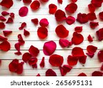 Stock photo red rose petals on light wooden background top view 265695131