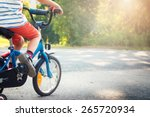 child on a bicycle at asphalt... | Shutterstock . vector #265720934