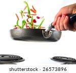 flipping veggies with pan...   Shutterstock . vector #26573896