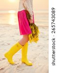 yellow wellies and yellow mimosa | Shutterstock . vector #265743089