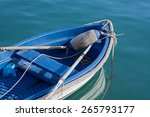 A Bright Blue Row Boat Anchore...